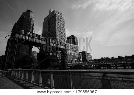 iconic gantries of Gantry State Park and fence next to river in black and white