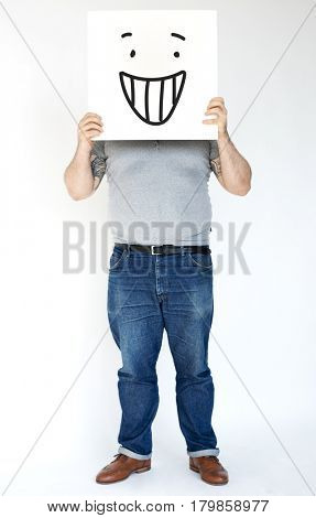 Man Face Covered with Smile Face Paper Board