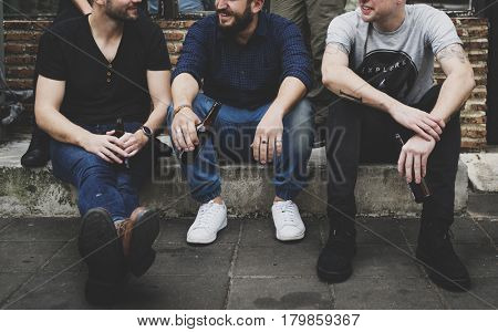 Group of People Sitting Together Outdoors