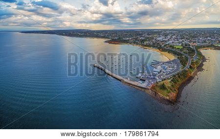 Aerial Panoramic View Of Mornington Pier And Peninsula Coastline, Showcasing The Yacht Club, Moored