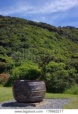 Historic Whaling Pot on Kapiti Island Bird Santuary New Zealand. In the background is the pristine native bush.