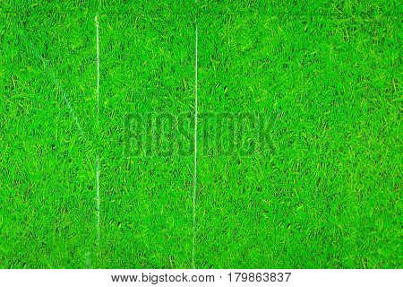 Plastic table cover with image of grass.