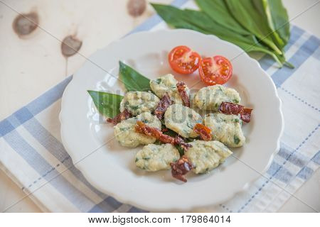 home made wild garlic gnocchi with bacon and cheese