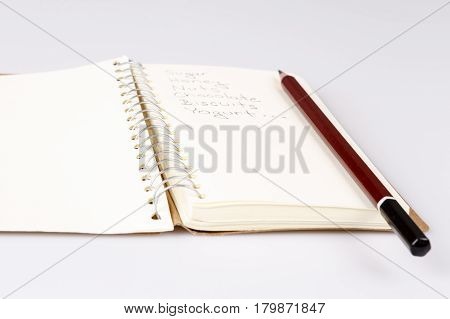 Shopping List In The Diary With Pencil