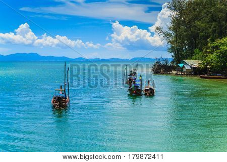 The long tail boats and Fishing village with blue sky.