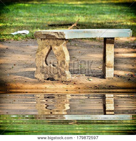 Old Marble benches on garden with reflection