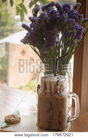 Iced Coffee On Wooden Table Top stock photo