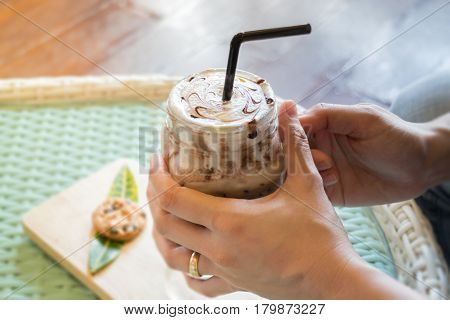 Hand On Iced Chocolate Drink stock photo
