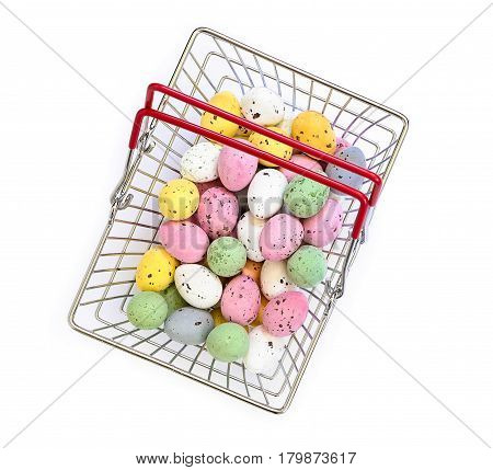 Small Painted Chocolate Eggs In A Small Supermarket Basket On A White Background.