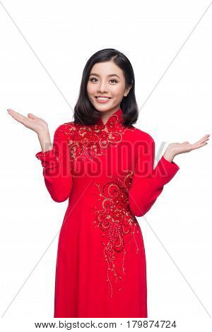 Charming Vietnamese Woman In Red Ao Dai Traditional Dress Present Something.
