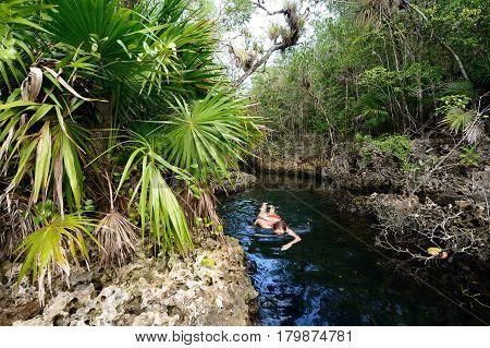 Diving tourist in Cueva de los Peces it is a 70m-deep cenote on the south coast of Cuba near Giron beach