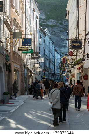SALZBURG AUSTRIA - APRIL 29 2016: Unidentified People Walking at Famous Historical Shopping Street Getreidegasse in Salzburg. Getreidegasse is one of the oldest streets in Salzburg