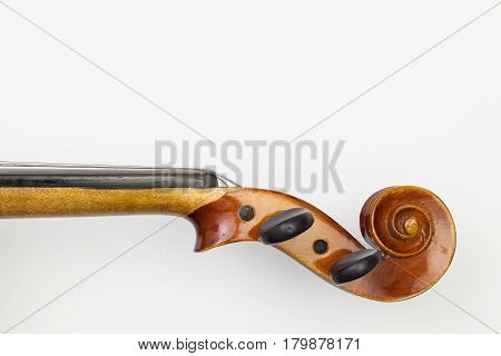 Top view close up shot of old violin on the white table. Flat Lay Image