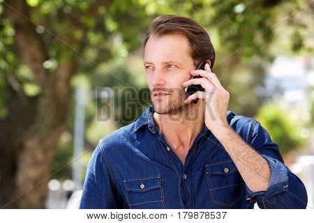 Cool Older Man Talking On Mobile Phone