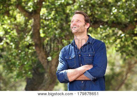 Older Handsome Man Laughing Outside