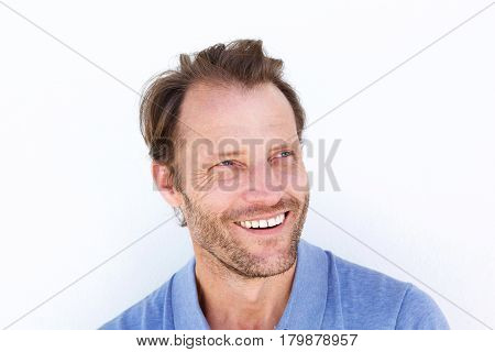 Close Up Smiling Older Man Against White Wall