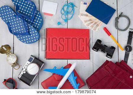 Plane, Passport, Money, Camera, Compass, Note Pad, Binoculars, Jeans, Watch, Flip Flops, Wallet