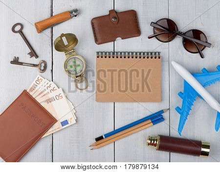Plane, Passport, Money, Compass, Sunglasses, Binoculars, Note Pad, Keys, Wallet