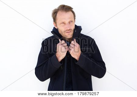 Handsome Man Keeping Warm With Jacket