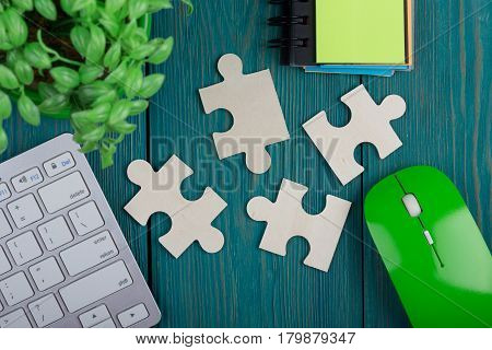 Puzzle Pieces, Sketchbook, Computer Keyboard And Mouse On A Blue Wooden Background