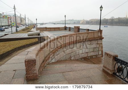The granite embankment of the river.Neva embankment covered with granite stones.