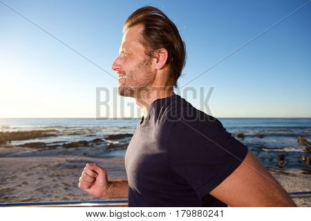 Male Runner Outside By Beach