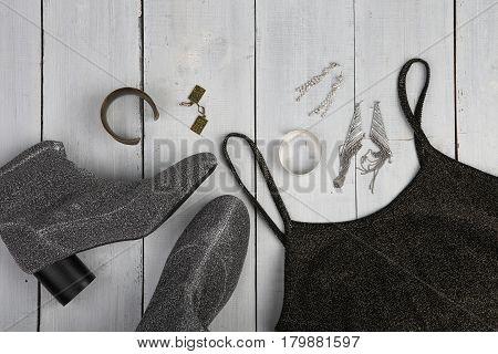 Set Of Woman Stuff On White Wooden Desk: Dress, Shoe, Accessories