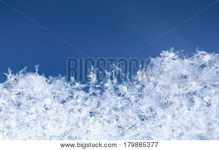 Snowy micro landscape formed by snow flakes in snowbank at winter Xmas night