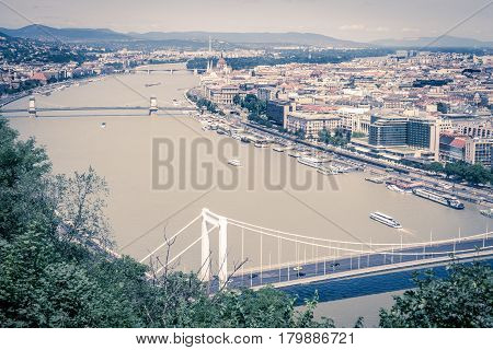 The stunning view overlooking Budapest in the daytime from Gellert Hill looking along the River Danube in a vintage toned image.