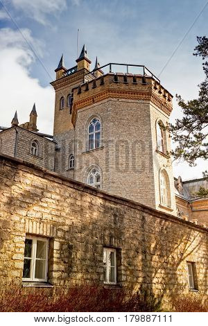 The towers of the Laitse castle rise above the staff quarters. You can clearly see the staff didn't live such a luxurious life as the landlords.