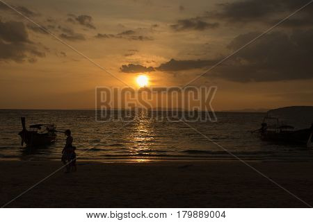 Silhouette On The Beach