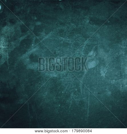 Grunge vintage dark blue abstract background with film grain, artifact and dirt
