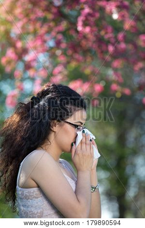 Girl With Allergic Reaction On Blooming Tree