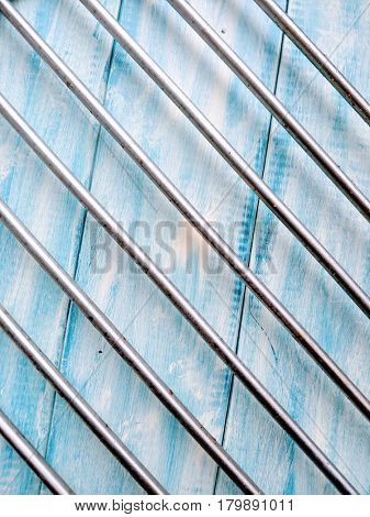 Abstract metal and blue wooden background