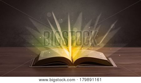 Yellow lights spreading from an open book