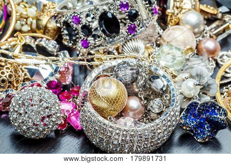 The Many fashionable women's jewelry. Brilliant bangles