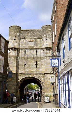 York Yorkshire England UK - May 22 2016 : Tourists walking near York City Roman wall surrounding the City