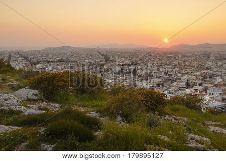 View of Athens from Filopappou hill at sunset, Greece.