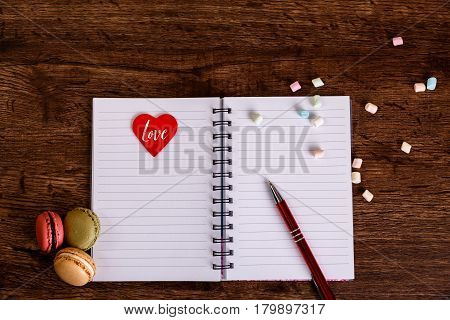 Woman diary with heart and Macaroons with marshmallows. Opened blank notebook. Valentines day concept. Dear diary.