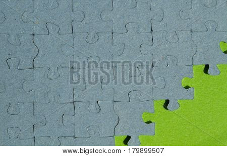 jigsaw puzzle piece background with green background with copy space