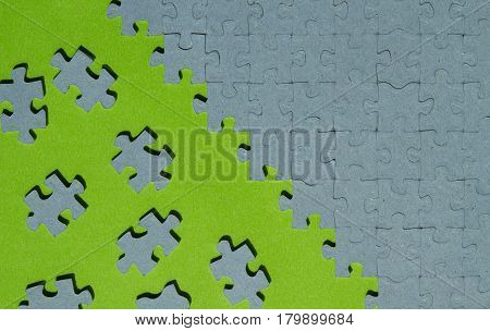 jigsaw puzzle piece cut out on green background with copy space horizontal view