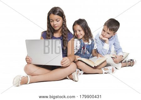 Children Using Devices And Books
