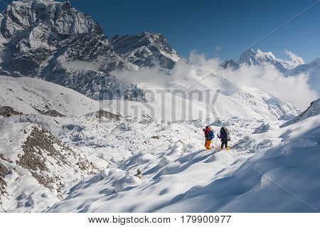 Trekkers Crossing Gokyo Glacier In Khumbu Valley On A Way To Everest Base Camp