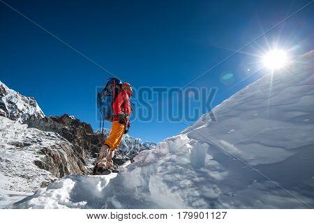 Trekker looks at the sun while crossing Cho La pass in Everest region Nepal
