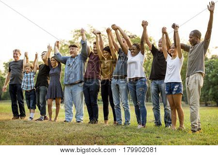 Group of people holding hands support team unity
