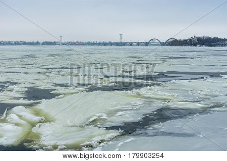 Winter landscape with ice formations on river Dnepr at January in Dnepr city Ukraine