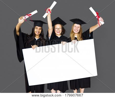 Diverse Students wearing Cap and Gown Showing Blank Copy Space Studio Portrait