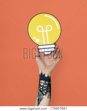 Human Hand Holding Light Bulb