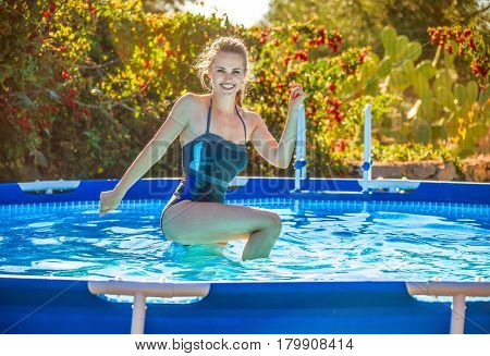 Smiling Active Woman In Swimming Pool Doing Aquatic Fitness