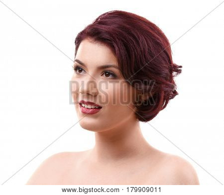 Portrait of young woman with beautiful haircut on white background